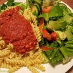 Basic pasta with tomato sauce and a simple salad