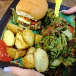 Bean burger with roasted potatoes and salad