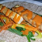 Grilled tofu strips in a wrap