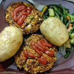 Home made bean burger patties with potatoes and veg