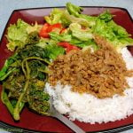 Lentils on rice with rapini and salad