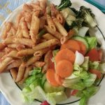 Pasta with a simple salad