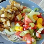 Potatoes with fresh mixed veg salad