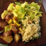 Roasted potatoes with rice pasta and a salad