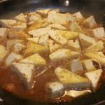 Tofu cooking in marinade