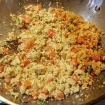 Tofu scramble with carrots, celery, tomatoes