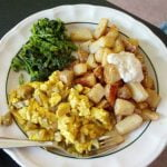 Tofu scrambles with cooked greens and potatoes