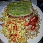 Tofu scrambles with hashbrowned potatoes and avocado on bread