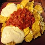 Tortilla chips with Daiya nondairy cheese, home made sour cream and salsa