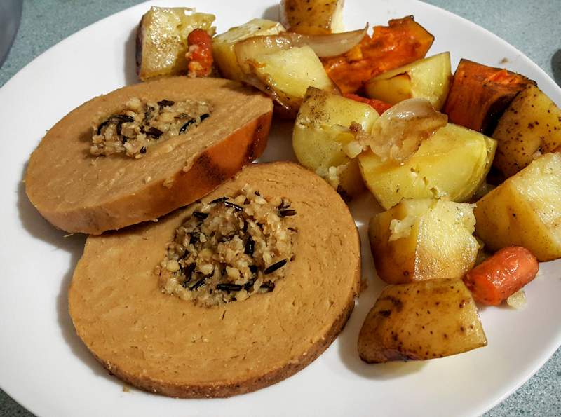 Tofurky roast served with potatoes