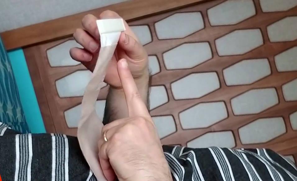 Burping an ostomy bag laying down