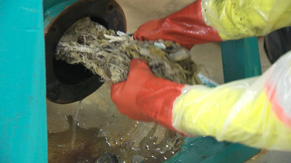 Non-flushable items being removed from piping