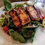 Marinated tofu on a bed of spinach